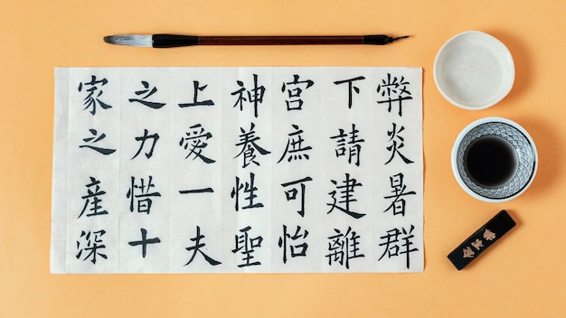 Top view composition of chinese symbols written with ink