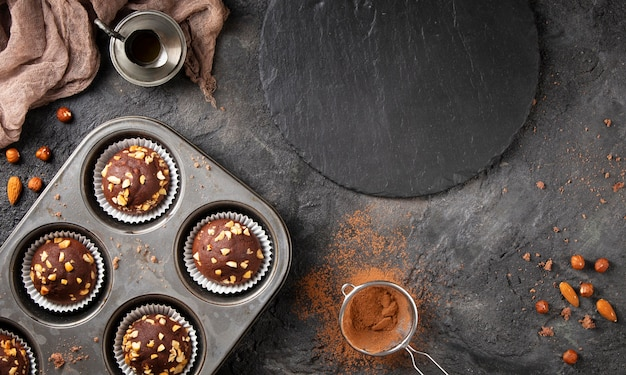 Top view composition of chocolate cupcakes with copy space