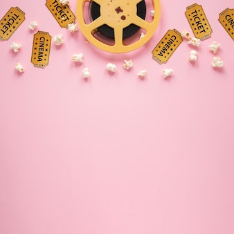 Top view composition of cinema elements on pink background with copy space