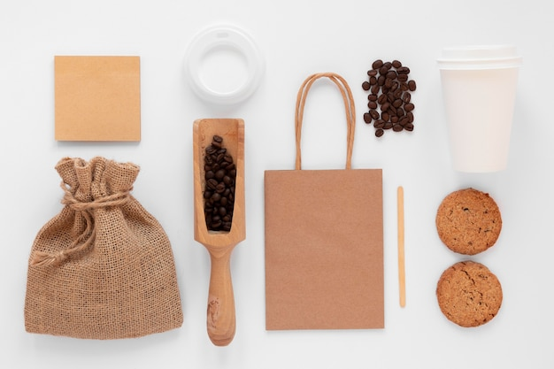 Top view composition of coffee shop branding elements