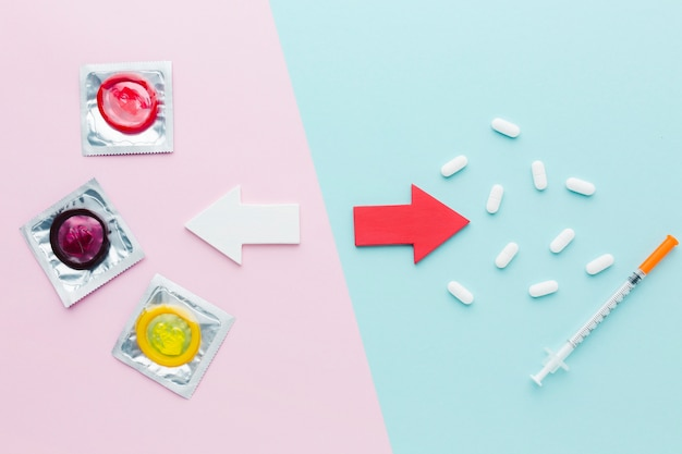 Top view composition of contraception concept on bicolor background
