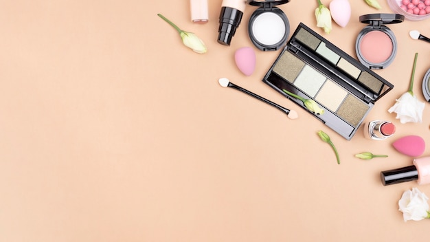 Top view composition of cosmetics with copy space
