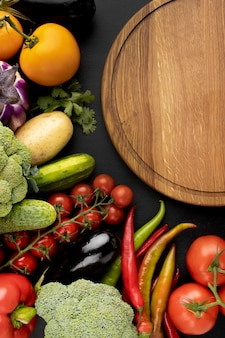Top view composition of delicious fresh vegetables