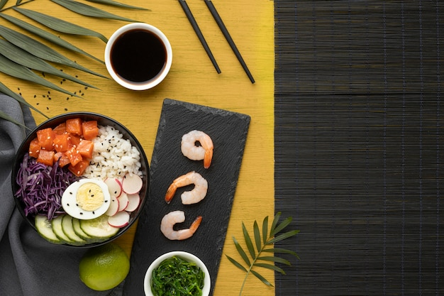 Top view composition of delicious poke bowl