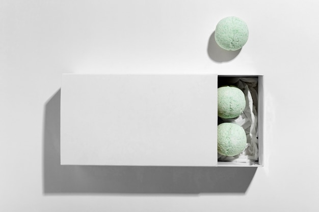 Top view composition of green bath bombs on white background