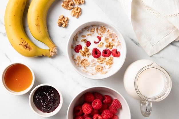 Top view composition of healthy bowl cereals and ingredients
