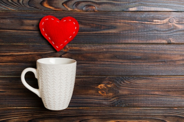 Top view composition of hearts splashing out from a cup