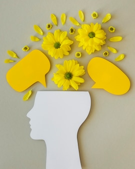 Top view composition of optimism concept with flowers