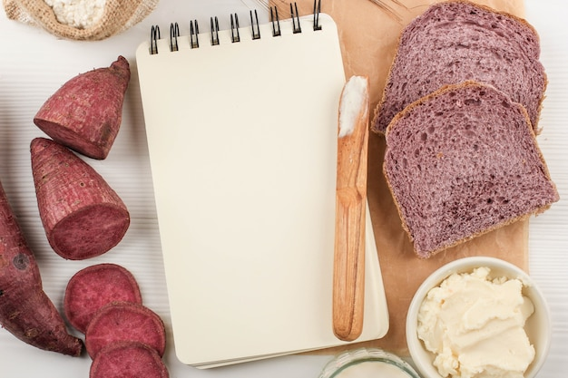Top view composition of slice homemade purple bread made from japanese purple sweet potato with natural color. concept for healthy diet bakery, copy space for text or recipe on white background