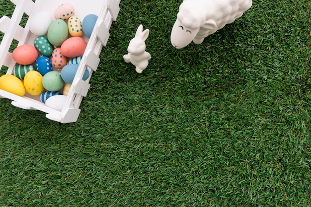 Top view of composition with fence and easter animals
