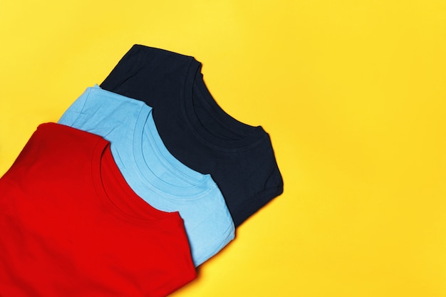 Top view of composition with multi-colored t-shirts
