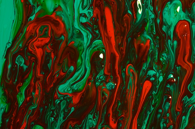 Top view composition with red and green paint
