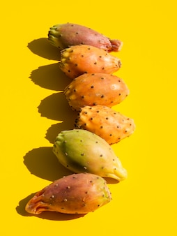 Top view composition with vegetables and yellow background