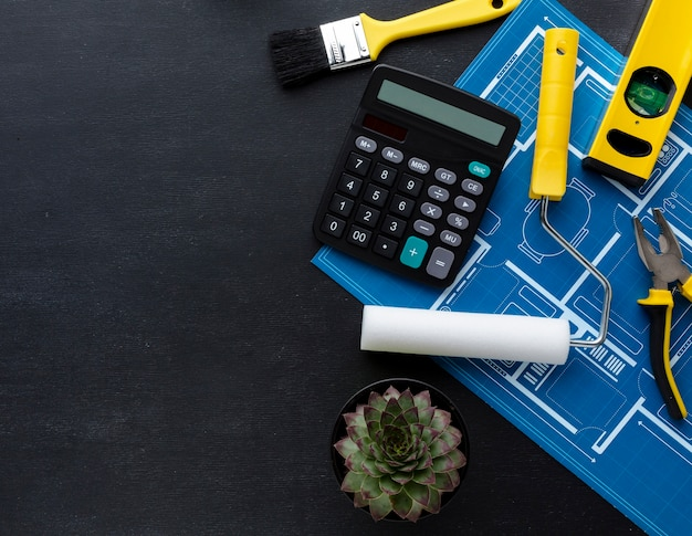 Top view construction calculator and repair tools with copy space