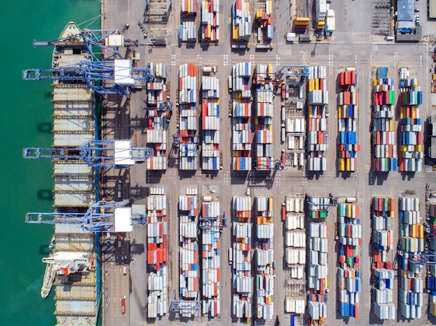Top view of container port and container ship transportation