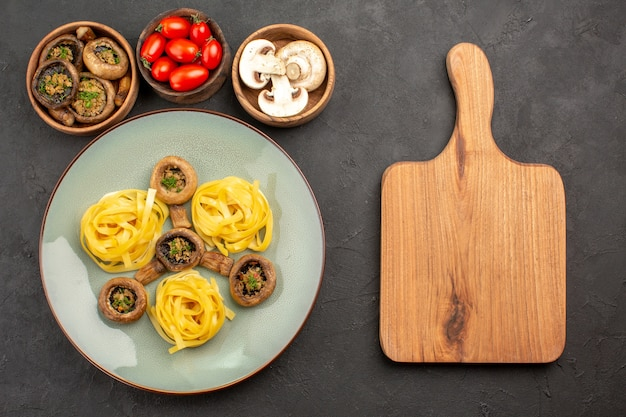 Top view cooked mushrooms with dough pasta on dark table food meal color dinner
