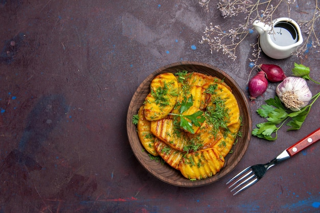 Top view cooked potatoes delicious dish with greens on dark surface cooking meal dish potato dinner