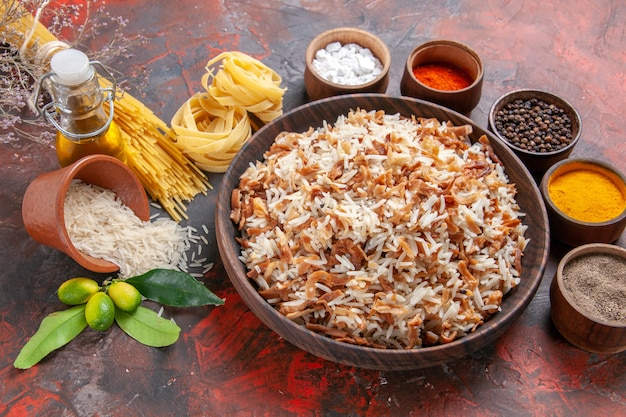 Top view cooked rice with seasonings on a dark surface photo meal dish