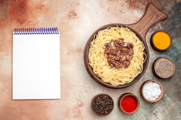 Top view cooked spaghetti with ground meat on light table pasta meat dough dish meal