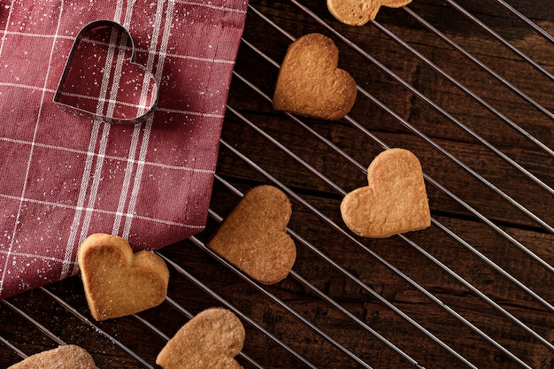Top view cookie hearts on metal grate with red cloth napkin