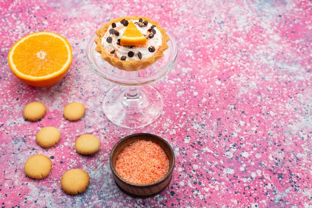 Top view cookies and cake with orange half on the bright surface cookie biscuit fruit cake sweet