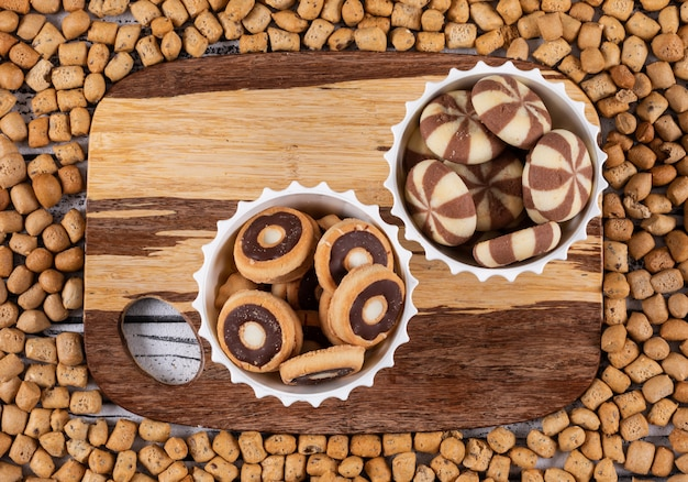 Top view of cookies on cutting board and on crackers texture horizontal
