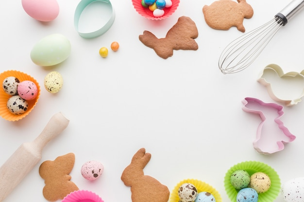 Top view of cookies for easter and kitchen utensils frame