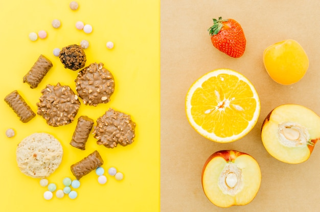 Top view cookies vs fruit