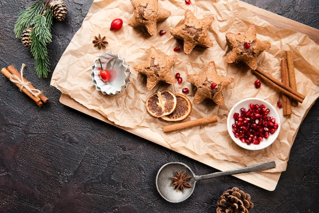 Top view of cookies with pomegranate and dried citrus