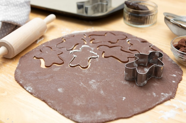 Top view of cooking process, festive christmas gingerbread chocolate cookies. cooking chocolate cookies or dessert.