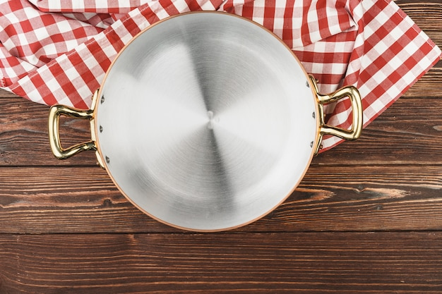 Top view of copper cooking pot on kitchen table