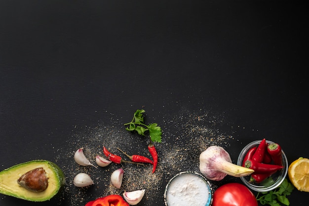 Top view copy space of different fresh ingredients for cooking on the black tables