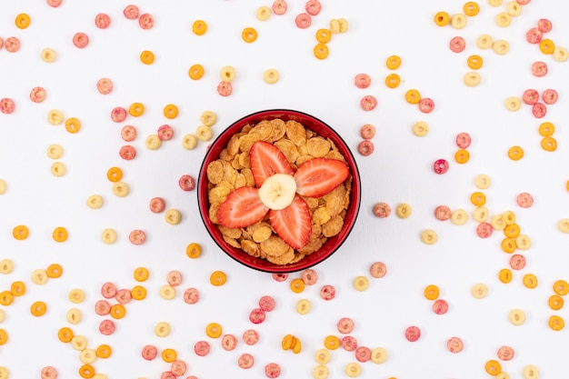 Top view of cornflakes on white surface horizontal