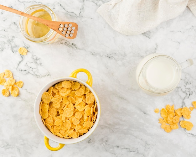 Top view cornflakes with yougurt and honey