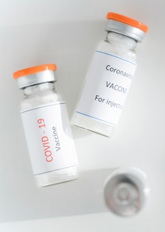 Top view coronavirus vaccine in bottle