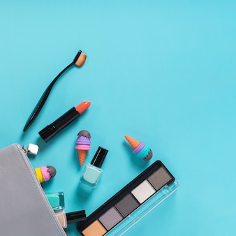 Top view of cosmetics on blue background
