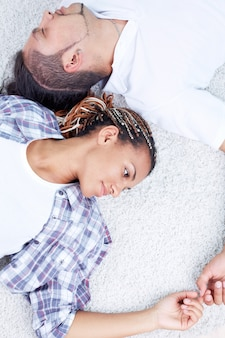 Top view of couple lying on the floor
