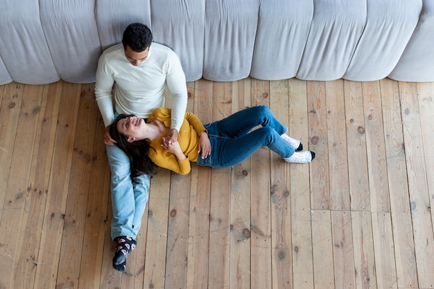 Top view of couple relaxing on the floor