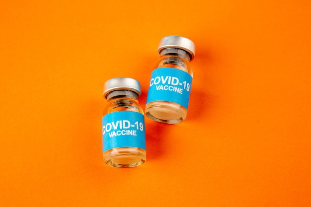 Top view of covid19 vaccine in little flasks