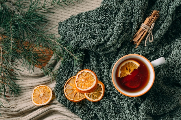 Top view cozy arrangement with tea and orange
