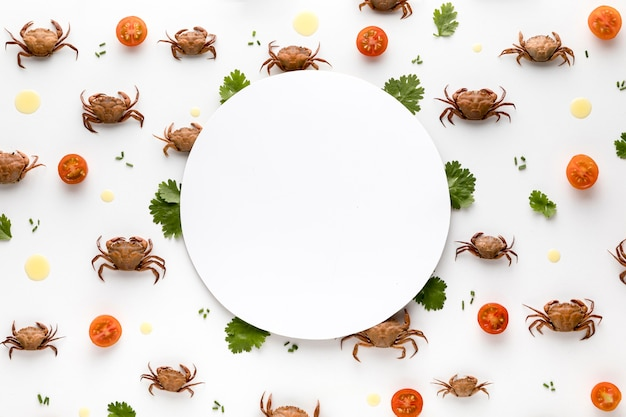 Top view of crabs and tomatoes with copy space