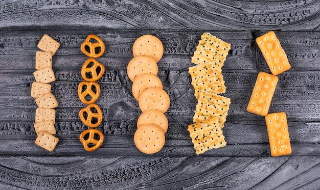 Top view of crackers on dark  horizontal