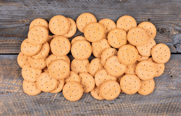 Top view of crackers on dark wooden  horizontal
