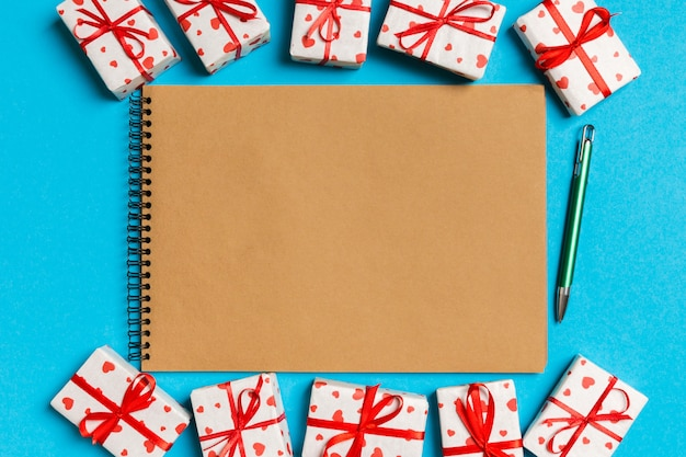 Top view of craft notebook surrounded with gift boxes