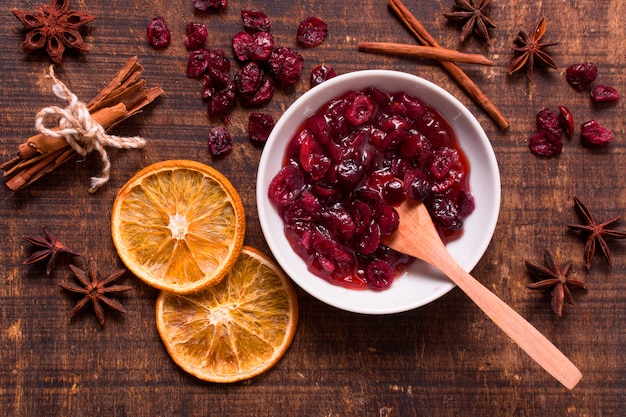 Top view of cranberry sauce with dried citrus