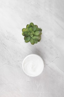 Top view of cream on marble background