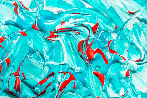 Top view of creative blue and red colored paint on surface Free Photo