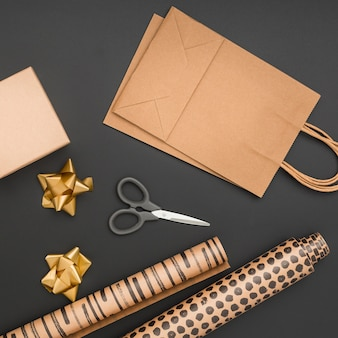 Top view creative gift wrapping assortment on dark background