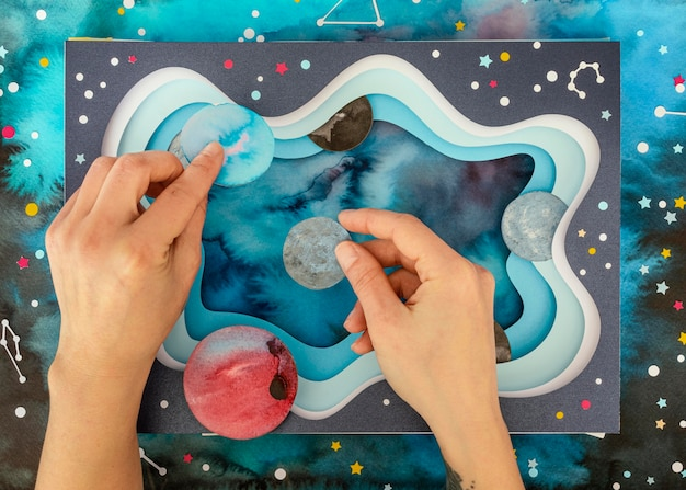 Top view creative paper planets assortment
