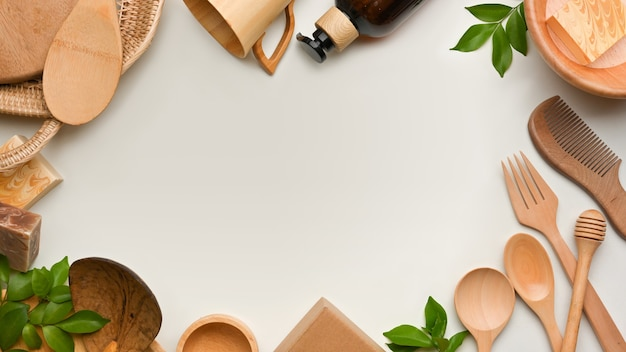 Top view of creative  scene with wooden kitchenware and copy space on white background